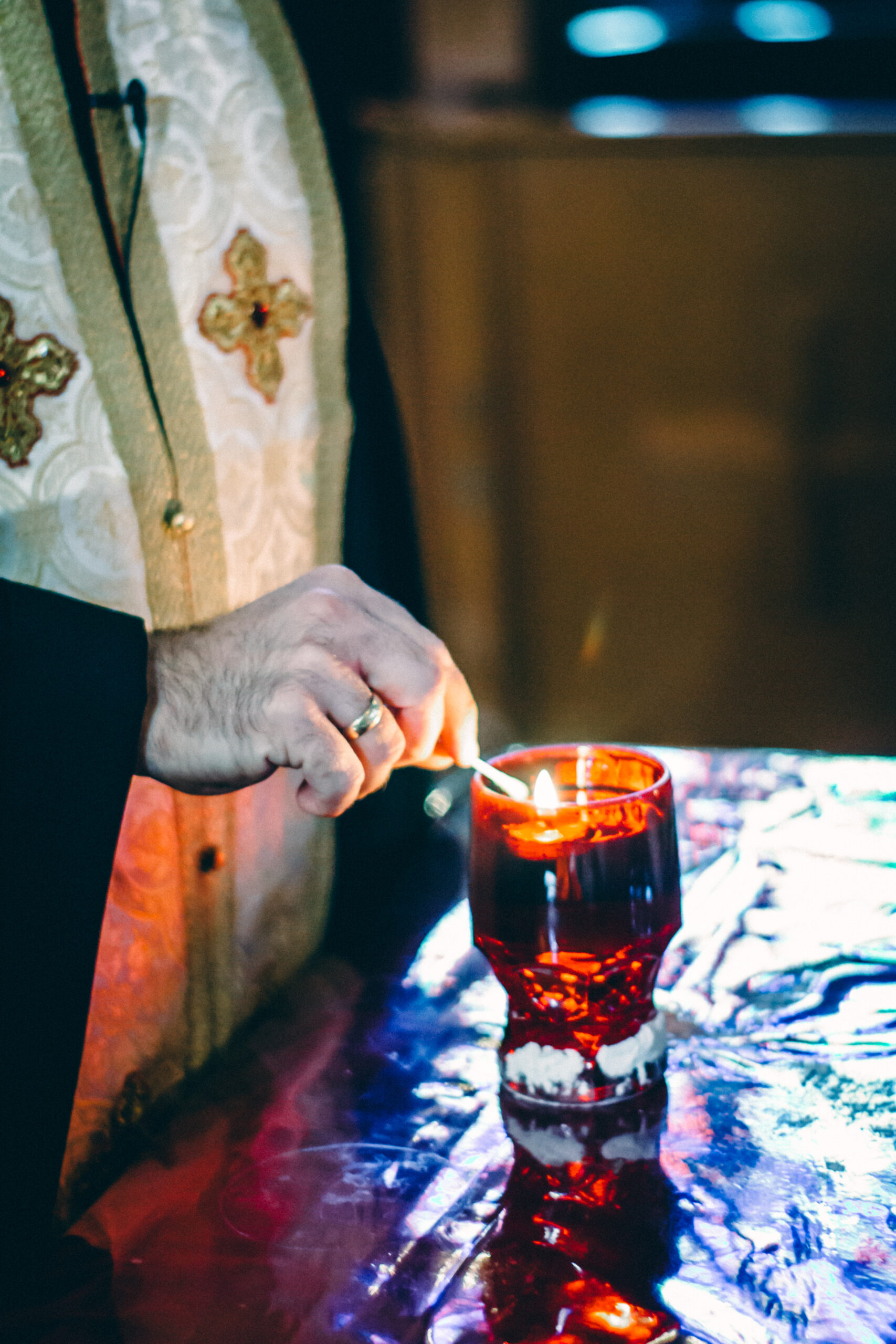Father Stavros taking Holy Oil